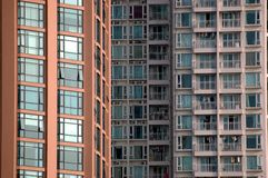 Residential buildings in Chinese city. China, modern Chinese skyscrapers close photo of two residential buildings Royalty Free Stock Photo