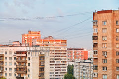 Residential buildings in city block at sunset Stock Photo