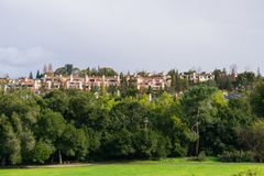 Residential buildings at the edge of a park on a stormy day, south San Francisco bay area, California stock images