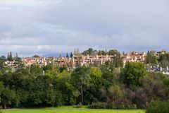 Residential buildings at the edge of a park on a stormy day, south San Francisco bay area, California royalty free stock photo