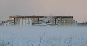 Residential buildings in fog on an early winter morning.  stock video