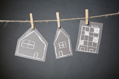 Residential Buildings Hanging with Clothespins Royalty Free Stock Image