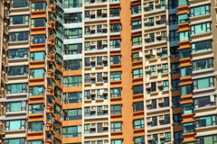 Residential buildings in Hong Kong. It is the private residential building in downtown of Hong Kong. It is in orange and green color Royalty Free Stock Images