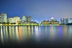 Residential buildings by Kallang River at night Stock Photos