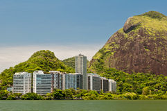 Residential Buildings and Mountains around the Lake Royalty Free Stock Images