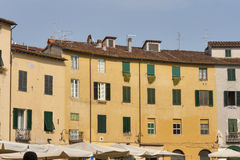 Residential buildings on oval Amphitheater Square in Lucca, Ital Royalty Free Stock Photos