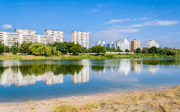 Residential buildings over a lake Royalty Free Stock Images
