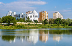Residential buildings over a lake. Kyiv, Ukraine Royalty Free Stock Photo