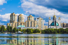 Residential buildings over a river Royalty Free Stock Image