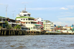 Residential buildings seen from boat along the Chao Phraya River Stock Photos