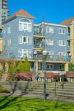 Residential buildings with small park zone in front. Winter season in Vancouver Royalty Free Stock Photo