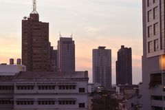 Residential buildings in sunset sky. View of several residential buildings in Bangkok with a moody sunset just before nightfall Royalty Free Stock Image