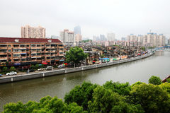Residential buildings beside Suzhou river, Shanghai. Residential Buildings beside Suzhou river with green trees in Shanghai, China.We call Suzhou river as Mother Stock Photos
