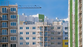 Residential buildings under construction against blue sky Royalty Free Stock Image