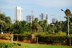 Residential buildings under construction near park. Stock Photos
