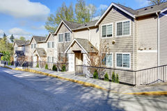 Residential community house. Big residential siding house with drive way Royalty Free Stock Images