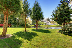 Residential complex backyard garden with pond, trees and sitting Royalty Free Stock Image