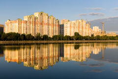 Residential complex next to the river-Moscow at dawn. Royalty Free Stock Photos