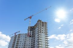 Residential complex real estate, under construction areas with high cranes stock photos