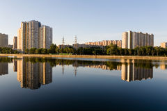 The residential complex is reflected in the Moscow River at dawn Royalty Free Stock Image