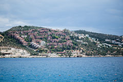 Residential complexes located on hills of Kalkan Turkey. KALKAN, TURKEY - MAY 22 View of residential complexes and villas located on hills of Kalkan resort town Royalty Free Stock Photo