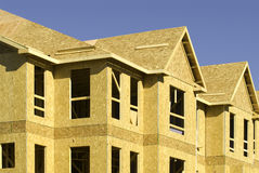 Residential construction. A side angle view of the carpentry stage of a residential building under construction Royalty Free Stock Image