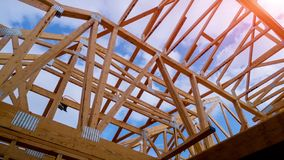 Residential home framing view on new house wooden under construction. Residential construction home framing view on new house wooden under construction royalty free stock image