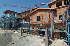 Residential Construction site. With scaffolding and crane Stock Images