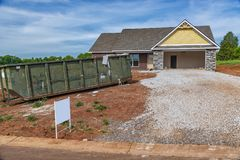 Residential Construction Site With Trash Dumpster Stock Photo