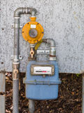 Residential diaphragm external gas meter regulator valves and pi. Residential diaphragm external gas meter with regulator, shut-off  valves and pipes Royalty Free Stock Image