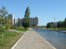 Residential district. Astana, view on the residential district near the Presidential park; some pathes in the park Royalty Free Stock Photography