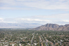 Residential district and mountains against cloudy sky Stock Photo