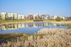 Residential district with a pond park. Stock Image