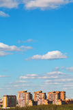 Residential district under bue spring sky. With white clouds royalty free stock image
