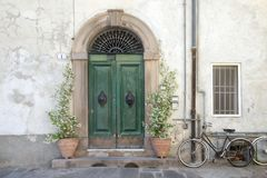 Residential doorway detail from the medieval town Lucca, Italy. Residential doorway detail from the medieval town Lucca, Tuscany, Italy Royalty Free Stock Photography