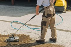 Residential Driveway Washing. And Cleaning Using High Pressured Water Royalty Free Stock Image