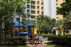 Residential estate. With playrground on the foreground Royalty Free Stock Photo