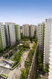 Residential estate. Vertical high angle shot of a residential estate with roof facilities of park and playground Royalty Free Stock Photos