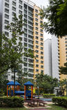 Residential estate. A vertical shot of a residential estate with playrground on the foreground Stock Photo