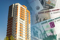Residential high-rise house on the background of banknotes . Royalty Free Stock Images