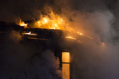 Residential home on fire stock photography
