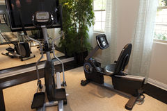 Residential home gym. Luxury home gym with modern exercise equipment Stock Photo