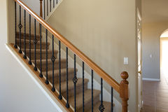 Residential home new iron and wood stairwell. New residential home carpet stairs and railing Stock Photos