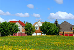 Residential homes. Residential upscale homes with park view in the spring Stock Photos
