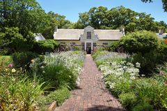 Residential homestead and garden in Vergelegen. SOMERSET WEST, SOUTH AFRICA - DECEMBER 5: Beautiful garden and residential homestead, dating back to the 1700's Royalty Free Stock Image