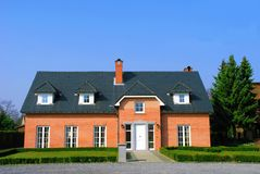 Residential house. In the suburbs, bright sunny day, blue sky.  Real estate concept Stock Photo
