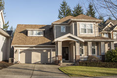 Residential house. A modern custom built luxury home in a residential neighborhood Royalty Free Stock Photography