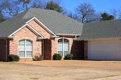 Residential House. Residential, modest brick house in Texas Royalty Free Stock Image