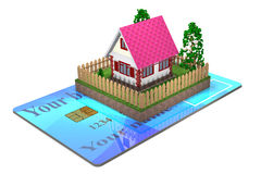 Residential house and a bank card. Stock Photography