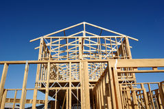 Residential house construction. Timber frame of house under construction stock photos